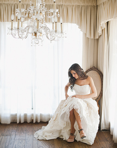 bride getting ready, chandelier, wooden floor, fancy chair, wedding
