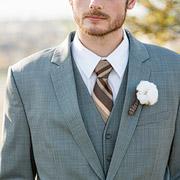 close up detail of the groom, cotton boutonnière