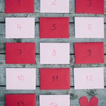 Pink and red envelopes from Paper Source with Valentine's Day countdown calendar