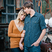 Portrait of a couple in front of the abandoned train cars
