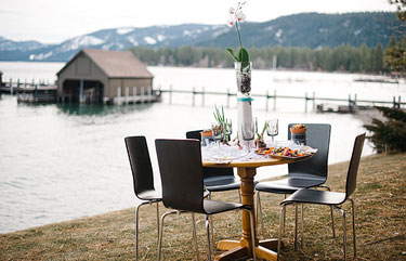 table, chairs, table details, mountains, dock, lake, water