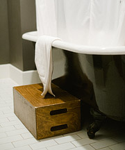 Ace hotel bathtub with a wooden box as a step stool