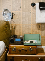 Ace Hotel suitcases and lamp used as a side table