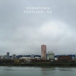 Cityscape of Portland, OR with clouds and the river