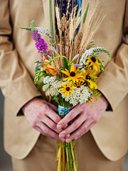 Groom holding the wedding bouquet