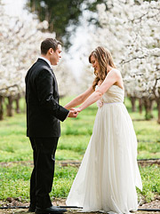 Becca and Orion's first look in the cherry orchard wearing Sarah Seven wedding dress