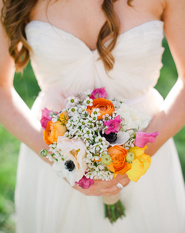 Bride holding the bouquet of beautiful flowers designed by Floral Theory