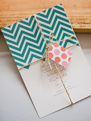 Wedding invitation tied with a brown string