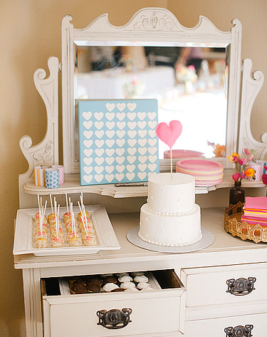 Dresser topped with sweets and wedding desserts inside the drawers