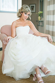 Gorgeous bride wearing a fluffy dress inside the suite of the Sofitel Hotel