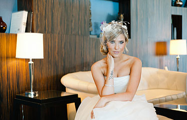 Gorgeous bride sitting in the hotel lobby looking into the camera