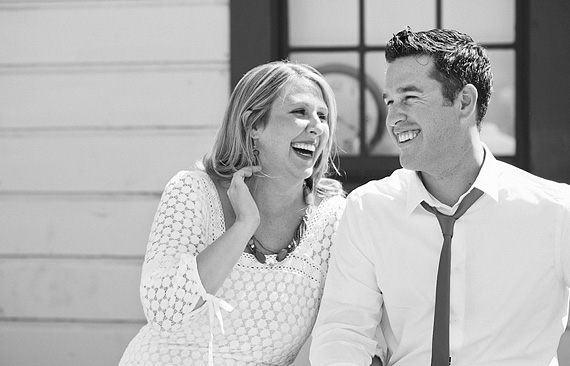 Black and white photo of a couple laughing together