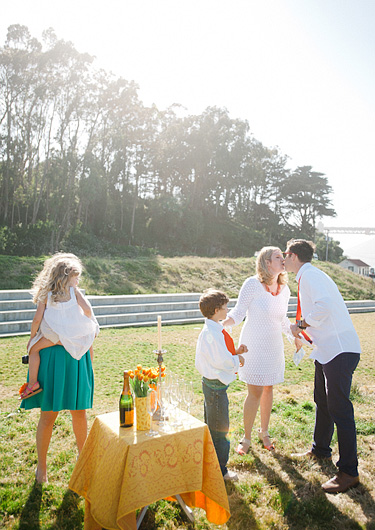 Couple renewing their vows in San Francisco with their kids watching