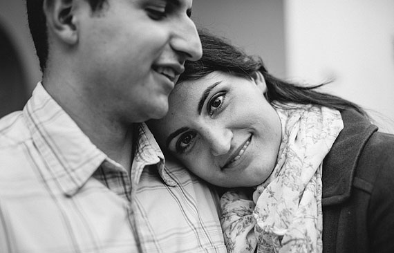 Balck and white image of a girl leaning on her fiancee's shoulder
