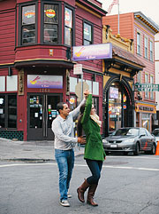 A couple dancing on the street in North Beach, San Francisco, CA