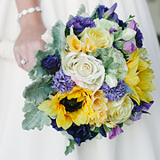 Bride holding wedding bouquet of flowers