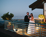 Bride and groom portrait at Thomas Fogarty Winery after sunset. beautiful view of the skyline.