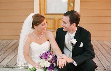 Bride and groom laughing on the porch of a house in New Town, MO St. Louis Wedding photography