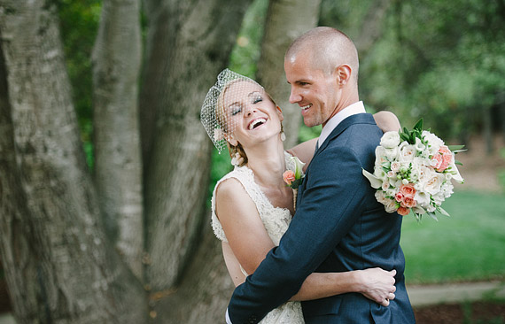 Portrait of bride and groom laughing together