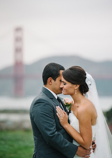 Portrait of bride and groom with Golden Gate Bridge in the background
