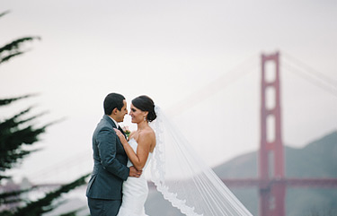 Bride and groom portrait with Golden Gade bridge in the background.