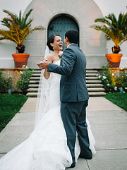 Bride and groom dancing and laughing together in San Francisco Presidio in front of Film Centre
