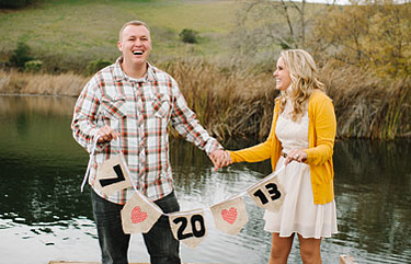 Holding wedding date sign
