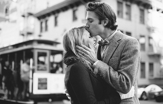 Brian gently kissing Shayla on the forehead with cable car in the background. San Francisco, black and white photography, 1950's inspired portraits