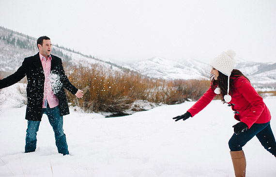 Girl throwing snowball at a guy. Fun date idea for winter and snow.