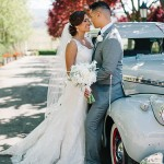 Bride and groom with gray 1940 Chevy