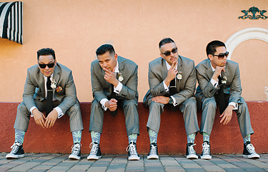 Groomsmen wearing gray suits and green marijuana socks