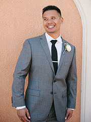 Groom wearing a gray suit and black tie