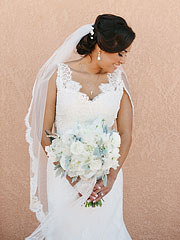 Bride holding a lovely bouquet from Floral Theory