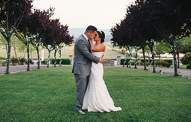 Landscape photo of bride and groom at Rios-Lovell Winery