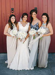 Bridesmaids wearing long flowing dresses. Florals by Floral Theory