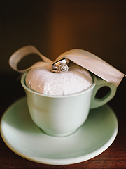 Wedding rings inside of a mint teacup