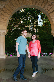Porrait of an engaged couple inside the Stanford University archway.