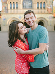 Couple laughing in front of Stanford Memorial Church on Stanford University campus.