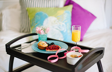 Tray with breakfast food for anniversary date idea