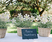 Table numbers / escort cards shaped like a pinwheel flower