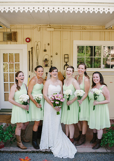 Bride with her bridesmaids laughing.