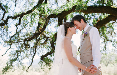 Bride and groom portrait under an oak tree. Beltane ranch photography.