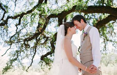 Bride and groom portrait under an oak tree. Beltane ranch photography.