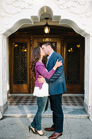Couple kissing in front of an old Sna Francisco building. Engagement photos.