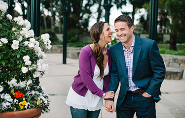 Couple holding hands and laughing. San Francisco engagement photos.