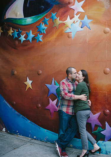 Engagement photos in San Francisco in front of a mural