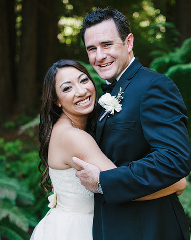 bride and groom smile big at Nestldown Los Gatos