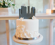 Cake with a skyline cake topper by honeycomb events and design