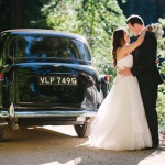 Bride and Groom embrace in front of taxi at Nestldown Los Gatos