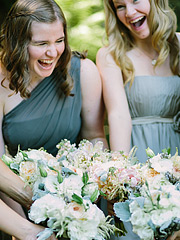 Junior Bridemaids laughing and holding flowers at Nestldown